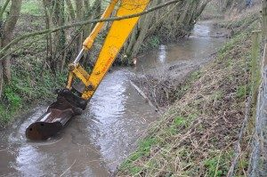 Excavating a pool - Dom Arnold on digger. Note the woody debris installation up-stream